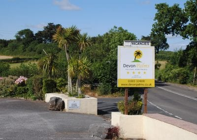 Devon Palms Front Sign
